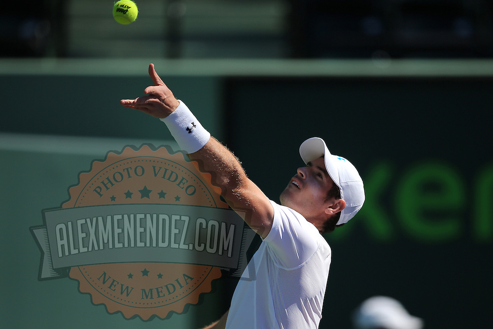 Andy Murray of Great Britain serves the ball to Santiago Giraldo of Columbia during their match at the Miami Open tennis tournament on Sunday, March 29, 2015 in Key Biscayne, Florida. (AP Photo/Alex Menendez)