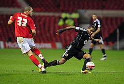 Bristol City's Marvin Elliott tackles Nottingham Forest's Joel Lynch - Photo mandatory by-line: Matt Bunn/JMP - 25/01/2011 - SPORT - FOOTBALL - npower championship-Nottingham Forest v Bristol city-City Ground-Nottingham
