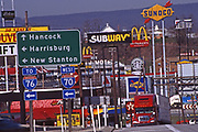 Jumble of hotels, fast foods and gas stations serve truckers and motorists near I-76 and I-70 exits.