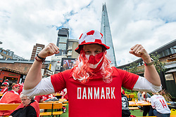 © Licensed to London News Pictures. 07/07/2021. LONDON, UK.  A Denmark football fan gestures in Vinegar Yard, Bermondsey, ahead of the Euro 2020 semi-final between England and Denmark at Wembley Stadium.  Photo credit: Stephen Chung/LNP