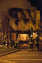 © Licensed to London News Pictures. 08/08/2011. LONDON, UK. Fire crews tackle a blaze at the House of Reeves furniture store in Croydon after it was set alight by rioters. The fire took place as Croydon was hit during a third night of violence across London which also spread to at least three other cities in the United Kingdom. Photo credit: Matt Cetti-Roberts/LNP