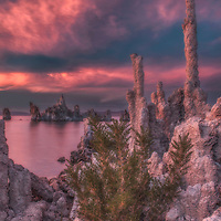 Dramatic sunset light on high clouds above tufa formations at Mono Lake, California.