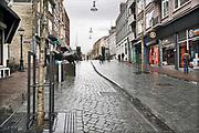 Nederland, Nijmegen, 13-3-2020 Het is duidelijk rustiger en stiller in de straten, winkelstraten van het centrum in de stad . Mensen blijven thuis om zo min mogelijk risico te nemen ivm het corona virus . Foto: Flip Franssen