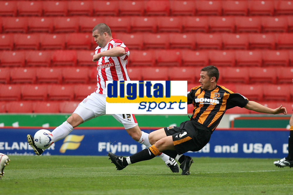 Photo: Pete Lorence.<br />Stoke City v Hull City. Coca Cola Championship. 21/04/2007.<br />Dominic Matteo claers the ball from a tackling Andy Dawson.