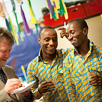 Picture Shows : Teachers Ayakwa Kwabena(c), Patrick Asiedu (r) of Juliet Johnson School, Ghana..Muthill Primary School, Muthill by Crieff, Perthshire, Scotland stage an evening of international cooking to celebrate their joint work with a partner school Juliet Johnson School, Ghana which is visiting this week. They have strong links with the Ghanians and have helped to raise money to contribute toward funding a new school bus.   Feature for TESS..Picture Drew Farrell Tel : 07721-735041