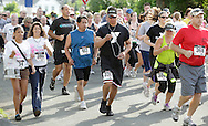 Middletown, New York - Runners and walkers take off at the start of the 15th annual Ruthie Dino Marshall 5K Run and Fun Walk hosted by the Middletown YMCA on Sunday, June 5, 2011. ©Tom Bushey / The Image Works