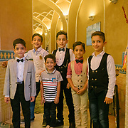 Boys dressed up for a wedding. Surrounded by desert, the city of Yazd is famous for its architecure, its wind towers and its traditional zoroastrian community of fire worshippers.  <br /> <br /> Travelling over 4000km by train across Iran. An opportunity to enjoy Persian hospitality, discover Iran's ancient cities and its varied landscapes, from deserts to mountains.
