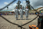 From behind a wire fence separating visitors from inmates, women from Langata Maximum Security Prison perform during celebrations of Talent Behind Bars, a programme held for International Day of the Gifted by the Government of Kenya and representatives from NGOs at the Nairobi Remand and Allocation Prison in the city's Industrial Area, built in 1911 by the British during the colonial period. Participants and inmates came from the Remand and Allocation Prison, Kamiti Main and Medium Prisons and Langata Women's Prison. 10 August 2012