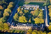 Nederland, Drenthe, Gemeente Noordenveld, 04-11-2018; gevangenisdorp Veenhuizen, gesticht door de Maatschappij van Weldadigheid voor bedelaars en landlopers. Esserheem, Huis van Bewaring voor vreemdelingen in strafrecht. Onderdeel van Penitentiaire Inrichting (PI) Veenhuizen. <br /> Veenhuizen prison village, founded in 1823 by the Benevolent Society for the rehabilitation of beggars and vagrants. Esserheem, detention center for foreigners. Part of Penitentiary Institute (PI) Veenhuizen.<br /> luchtfoto (toeslag op standaard tarieven);<br /> aerial photo (additional fee required);<br /> copyright © foto/photo Siebe Swart