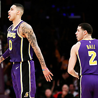 LOS ANGELES, CA - DEC 05: Kyle Kuzma (0) of the Los Angeles Lakers celebrates with Lonzo Ball (2) of the Los Angeles Lakers during a game on December 05, 2018 at the Staples Center in Los Angeles, California.