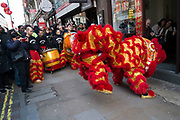 Busy street scene during Chinese New Year celebrations as a Lion Dance enters restaurants in Chinatown to bless them for the year ahead in central London, United Kingdom. Tens of thousands of people gathered in the West End filling the streets and joining in with the festival atmosphere. (photo by Mike Kemp/In Pictures via Getty Images)