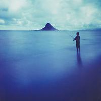 boy fishing at Kualoa Park shot with pinhole camera and Polaroid film
