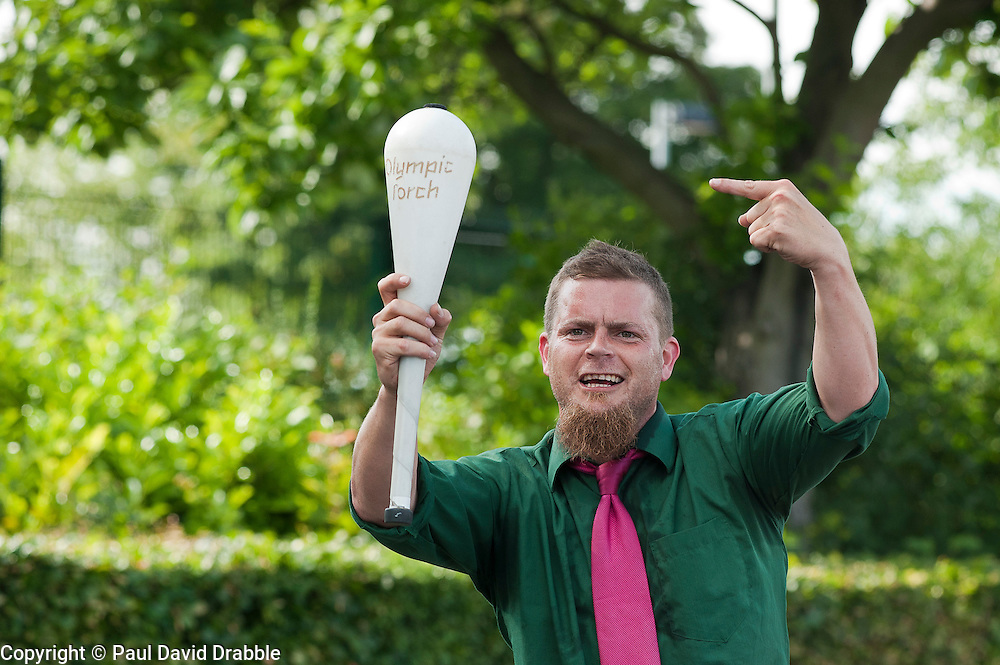 Olympic Torch reaches Sheffield Chapeltown/Ecclesfield/Parson Cross leg.<br /> Street entertainer on stilts with his own version of the Olypic torch<br /> 25 June 2012.Image © Paul David Drabble