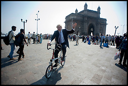London Mayor Boris Johnson rides a Bike around the Gate of India , Mumbai, on the final day of his 6 day tour of India, Friday November 30, 2012. Photo by Andrew Parsons / i-Images