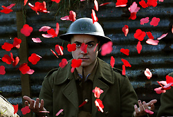 Poppies fall on actor James Dutton during the launch of the Poppyscotland fundraising challenge The 1918 Poppy Pledge. He is seen in a recreated First World War trench at Pollok Country Park in Glasgow.