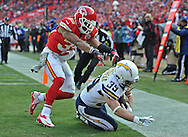 KANSAS CITY, MO - NOVEMBER 24:  Running back Danny Woodhead #39 of the San Diego Chargers scores a touchdown against safety Quintin Demps #35 of the Kansas City Chiefs during the first half on November 24, 2013 at Arrowhead Stadium in Kansas City, Missouri.  (Photo by Peter Aiken/Getty Images) *** Local Caption *** Danny Woodhead;Quintin Demps