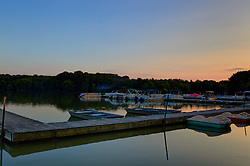 18 July 2014:  Dusk comes over the marina at Dawson Lake located in Moraine View State Park maintained by the Illinois Department of Natural Resources (IDNR) near Le Roy Illinois This images has been created in part using High Dynamic Range (HDR) or Panoramic Stitching processes.