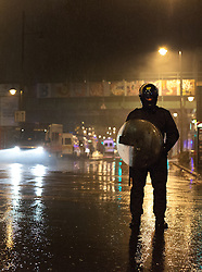 © Licensed to London News Pictures. 08/08/2011 LONDON, UK. Police guard the area around Brixton Station after youths looted and burnt several premises in the area. The looting took place after a second night of violence hit several parts London. Photo credit: Matt Cetti-Roberts/LNP