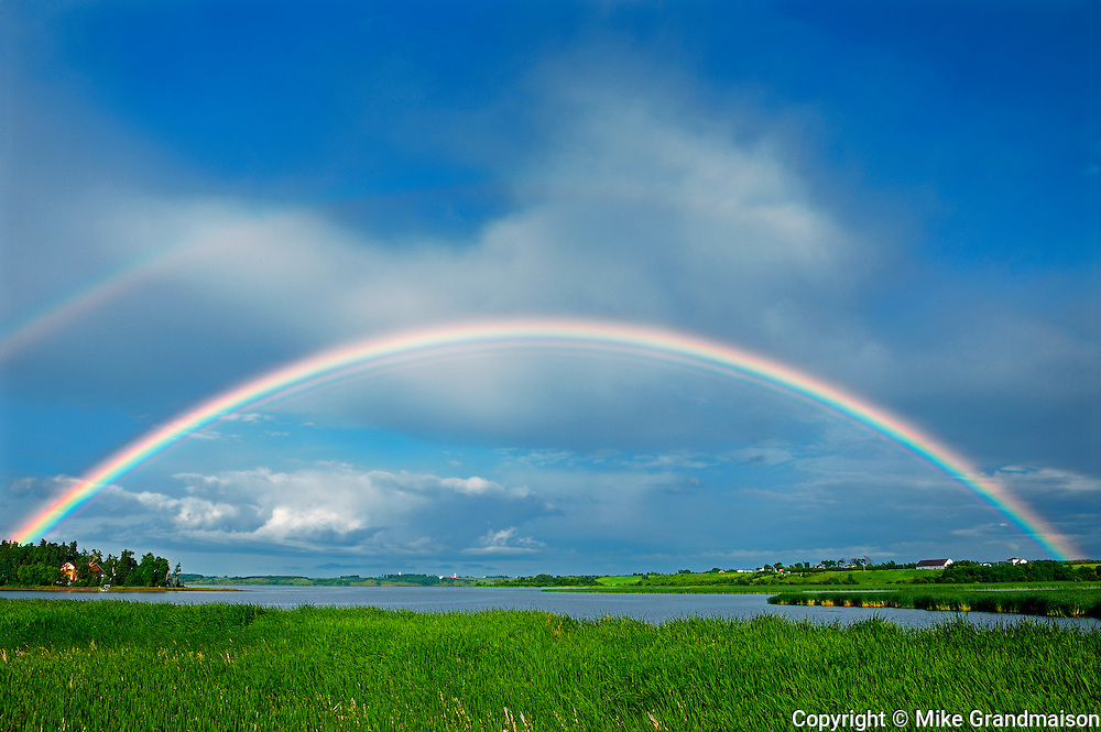Rainbow after storm in Lac St. Jean area<br /> St. Gedeon<br /> Quebec<br /> Canada