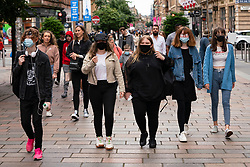 Glasgow, Scotland, UK. 17 July, 2020.  Images from Glasgow city centre as covid-19 restrictions are relaxed and  the public are out and about shopping and at work. Pictured; Young women walking on Buchanan Street wearing face coverings. Iain Masterton/Alamy Live News