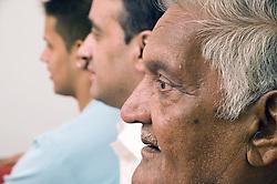 Three generations of men in profile,