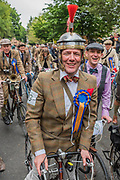 """Alternative safety gear - The Tweed Run - a group bicycle ride through the centre of London, in which the cyclists are expected to dress in traditional British cycling attire, particularly tweed plus four suits. Any bicycle is acceptable on the Tweed Run, but classic vintage bicycles are encouraged in an effort to recreate the spirit of a bygone era. The ride dubs itself """"A Metropolitan Cycle Ride With a Bit of Style."""" London 06 May 2017"""