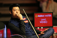 Liang Wenbo (Chn) looking on. Ronnie O'Sullivan v Liang Wenbo, 1st round match at the Dafabet Masters Snooker 2017, day 1 at Alexandra Palace in London on Sunday 15th January 2017.<br /> pic by John Patrick Fletcher, Andrew Orchard sports photography.