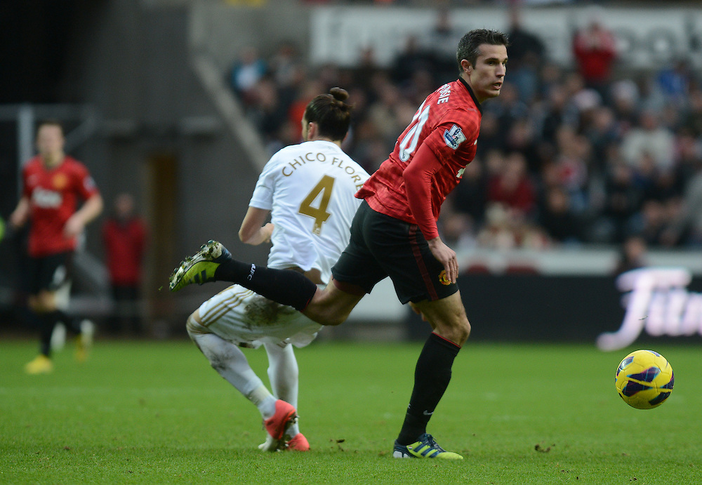 Manchester United's Robin van Persie beats Swansea City's Chico to the ball..Football - Barclays Premiership - Swansea City v Manchester United - Sunday 23rd December 2012 - The Liberty Stadium - Swansea..