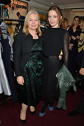 Left to right, SUSAN WEEKS and her daughter actress PERDITA WEEKS at a party hosted by Lady Kinvara Balfour, Lavinia Brennan and Lady Natasha Rufus Isaacs to celebrate the Beulah French Sole Collaboration in aid of the UN Blue Heart Campaign, held at George, 87-88 Mount Street, London on 10th December 2013.