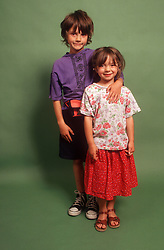 Portrait of brother and sister standing together,