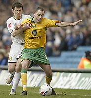 Photo: Aidan Ellis.<br /> Leeds United v Norwich City. Coca Cola Championship. 11/03/2006.<br /> Norwich's Andy Hughes holds off Leeds Liam Miller