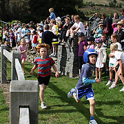 Youngsters in action during the Subway kids Duathlon series for 6-14 year old. The series allows children to compete in a safe and supportive environment. Lake Hayes, Queenstown, New Zealand. 26th February 2012. Photo Tim Clayton