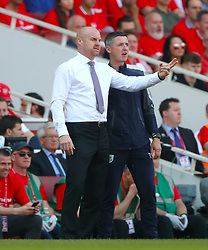 Burnley manager Sean Dyche (left) and First Team Coach Tony Loughlan gesture on the touchline