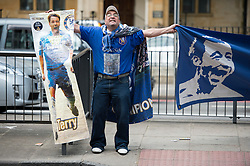 © London News Pictures. 13/07/2012. London, UK. A Chelsea FC supporter holding banners supporting John Terry outside  Magistrates court on July 13, 2012, where a verdict  of not guilty was returned today in John Terry's trial for allegedly using a racist obscenity about Queens Park Rangers player Anton Ferdinand. Photo credit: Ben Cawthra/LNP.