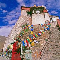 A Tibetan Buddhist monk circles the oldest castle in Tibet.