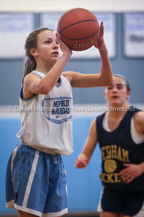 (12/3/16, MEDFIELD, MA) Medfield's Tess Patry  shoots for  three points during the girls basketball scrimmage against Needham at Medfield High School on Saturday. Daily News and Wicked Local Photo/Dan Holmes