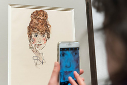 """© Licensed to London News Pictures. 31/10/2018. LONDON, UK. A visitor photographs """"Edith Schiele"""", 1917, by Egon Schiele. Preview of """"Klimt / Schiele:  Drawings from the Albertina Museum,Vienna"""" exhibition at the Royal Academy.  Over 100 works on paper are on display in an exhibition which marks the centenary of the deaths of the two most celebrated and pioneering figures of early twentieth-century art.  The show runs 4 November to 3 February 2019.  Photo credit: Stephen Chung/LNP"""