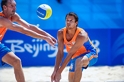 Reinder Nummerdor and Richard Schuil (L) of Netherlands, in action on the center court of the Chaoyang Park Beach Stadium on August 16, 2008 in Beijing