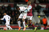 Divock Origi of Liverpool is challenged by Angelo Ogbonna Obinze of West Ham United. The Emirates FA cup, 4th round replay match, West Ham Utd v Liverpool at the Boleyn Ground, Upton Park  in London on Tuesday 9th February 2016.<br /> pic by John Patrick Fletcher, Andrew Orchard sports photography.