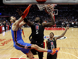 March 8, 2019 - Los Angeles, California, U.S - Oklahoma City Thunder's Abdel Nader (11) dunks against Los Angeles Clippers' Montrezl Harrell (5) during an NBA basketball game between Los Angeles Clippers and Oklahoma City Thunder Friday, March 8, 2019, in Los Angeles. (Credit Image: © Ringo Chiu/ZUMA Wire)