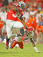 Ohio State's running back Carlos Hyde runs over Clemson's Darius Robinson and takes it to the Buckeyes on yard line in the third quarter. Clemson plays Ohio State at Sun Life Stadium during the Discover Orange Bowl in Miami Gardens on Friday, January 3, 2014.
