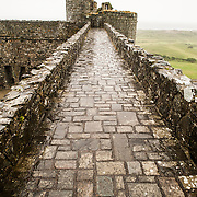 From the top of the ramparts at Harlech Castle in Harlech, Gwynedd, on the northwest coast of Wales next to the Irish Sea. The castle was built by Edward I in the closing decades of the 13th century as one of several castles designed to consolidate his conquest of Wales.