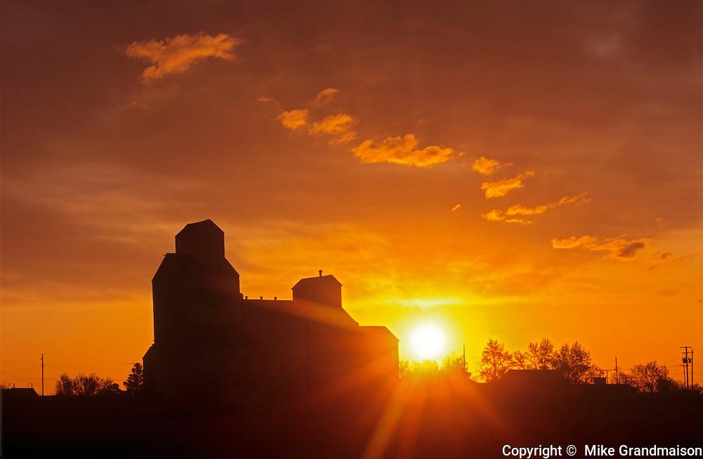 Grain elevators at sunset<br /> Denholm<br /> Saskatchewan<br /> Canada