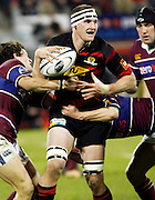 Canterbury flanker Kieran Read gets sandwiched by two Southland tacklers during the Air New Zealand Cup week 4 Ranfurly Shield match between Canterbury and Southland on Friday August 18, 2006 at Jade Stadium in Christchurch, New Zealand. Canterbury won the game 24-7. Photo: Jim Helsel/Photosport
