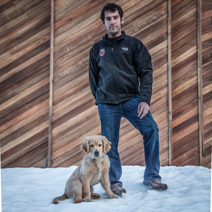 """Conoco Phillips engineer Wally Ward with his three month old Golden Retriever, Remington, in front of his home in Bootlegger Cove, Anchorage.  I am originally from Kenai and have lived in Anchorage for the past six months.  I like Anchorage; its only 20 minutes from Alaska!""""  wallyward@hotmail.com"""