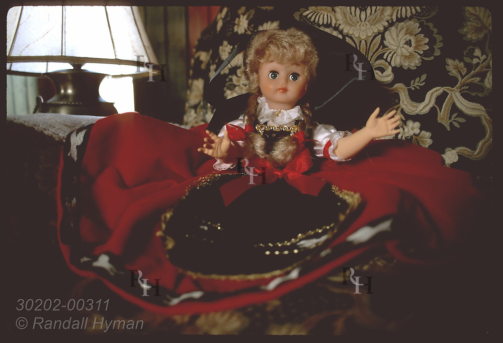 Doll in traditional Alsace costume sits on chair in reading room of Le Parc hotel; Obernai. France