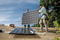 LA Solar Group foreman Jeff Shields, front, attaches a solar panel with help from Jose Calderon at a home in Culver City, CA. October 31, 2016. Photo by David Sprague