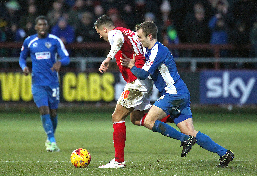 Fleetwood Town's Antoni Sarcevic vies for possession with Oldham Athletic's Liam Kelly<br /> <br /> Photographer Rich Linley/CameraSport<br /> <br /> Football - The Football League Sky Bet League One - Fleetwood Town v Oldham Athletic - Saturday 17th January 2015 - Highbury Stadium - Fleetwood<br /> <br /> © CameraSport - 43 Linden Ave. Countesthorpe. Leicester. England. LE8 5PG - Tel: +44 (0) 116 277 4147 - admin@camerasport.com - www.camerasport.com