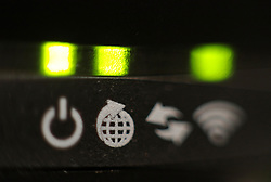 Embargoed to 0001 Thursday August 10 File photo dated 22/10/16 of the lights on the front panel of a broadband internet router. Consumers who pay for the fastest broadband speeds are receiving significantly slower connections than they expected, latest figures show.
