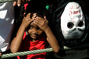 A child watches the Carnival Parade in Mindelo, the capital city of Sao Vicente island.
